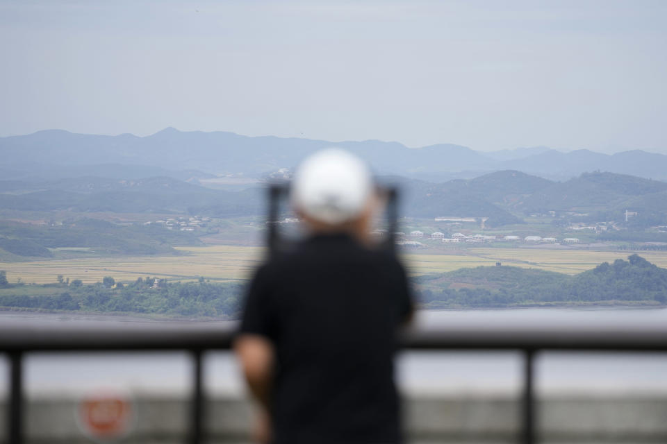 A visitor uses binoculars to see the North Korean side from the unification observatory in Paju, South Korea, Tuesday, Sept. 28, 2021. North Korea fired a short-range missile into the sea early Tuesday, its neighboring countries said, in the latest weapon tests by North Korea that has raised questions about the sincerity of its recent offer for talks with South Korea. (AP Photo/Lee Jin-man)