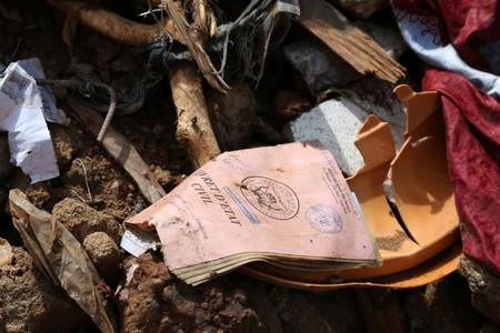 Belongings lay in the rubble of a collapsed building in Bamako