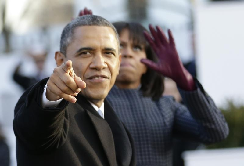 walk down Pennsylvania Avenue en route to the White House, Monday, Jan. 21, 2013, in Washington. Thousands marched during the 57th Presidential Inauguration parade after the ceremonial swearing-in of President Barack Obama. (AP Photo/Frank Franklin II)