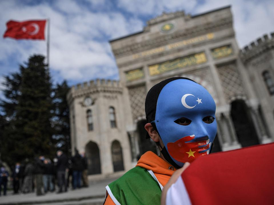 <p>A protest in Turkey against alleged forced birth control measures in Xinjiang, China </p> (AFP via Getty Images)