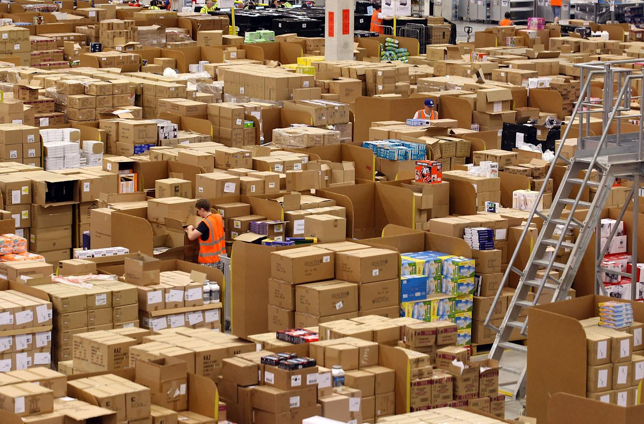 SWANSEA, WALES - NOVEMBER 24:  Staff at the Amazon Swansea fulfilment centre process orders as they prepare their busiest time of the year on November 24, 2011 in Swansea, Wales. The 800,000 sq ft fulfilment centre, one the largest of Amazon's six in the UK and the also the world, is gearing up for for both 'Black Friday' and 'Cyber Monday'. Black Friday is traditionally the discount shopping day that follows Thanksgiving in America and signals the start of the Christmas shopping period. In 2010 it is was reported that over 45bn USD was spent by shoppers in America over 'Black Friday' weekend. Cyber Monday, which this year is Monday December 5, and is predicted to be the UK's busiest online shopping day of the year with over 2 million orders expected to be made.  (Photo by Matt Cardy/Getty Images)