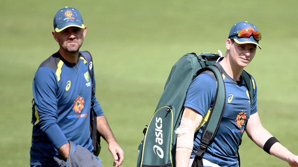 Ricky Ponting (pictured left) walking behind player Steve Smith (pictured right) at training.