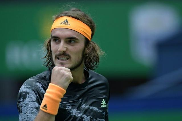 Stefanos Tsitsipas of Greece still has accounts on Twitter, YouTube and Instagram. But he now lets someone else run them (AFP Photo/NOEL CELIS)