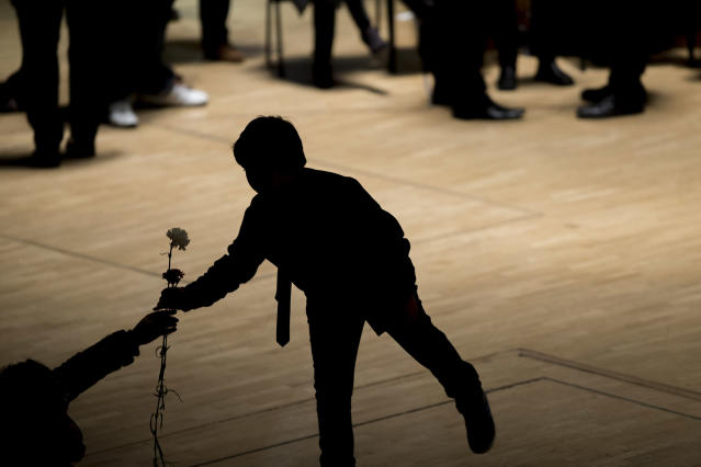 <p>Flamenco guitarist Paco de Lucía's son Diego receives a flower to place on his father's coffin during a wake at the National Auditorium in Madrid, Feb. 28, 2014. (AP Photo/Andres Kudacki) </p>