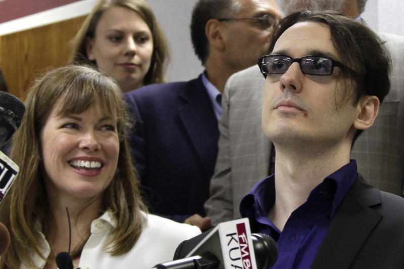 Damien Echols, right, and his wife Lorri attend a news conference at the Craighead County Court House in Jonesboro, Ark., Friday, Aug. 19, 2011, after Echols and two other men entered guilty pleas to to crimes they say they did not commit in order to be set free. The defendants, known by their supporters as the West Memphis 3, agreed to a legal maneuver that lets them maintain their innocence while acknowledging prosecutors have enough evidence against them. (AP Photo/Danny Johnston)