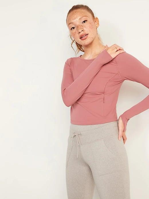 <p>The best thing about a rosy <span>Old Navy PowerSoft Long-Sleeve Cropped Performance Top</span> ($18, originally $35) is that secret zippered stash pocket on one side.</p>