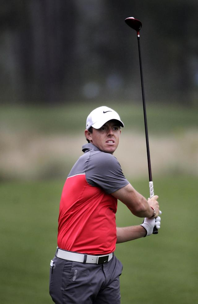 Rory McIlroy hits on the third hole during the first round of the Houston Open golf tournament on Thursday, April 3, 2014, in Humble Texas. (AP Photo/Patric Schneider)