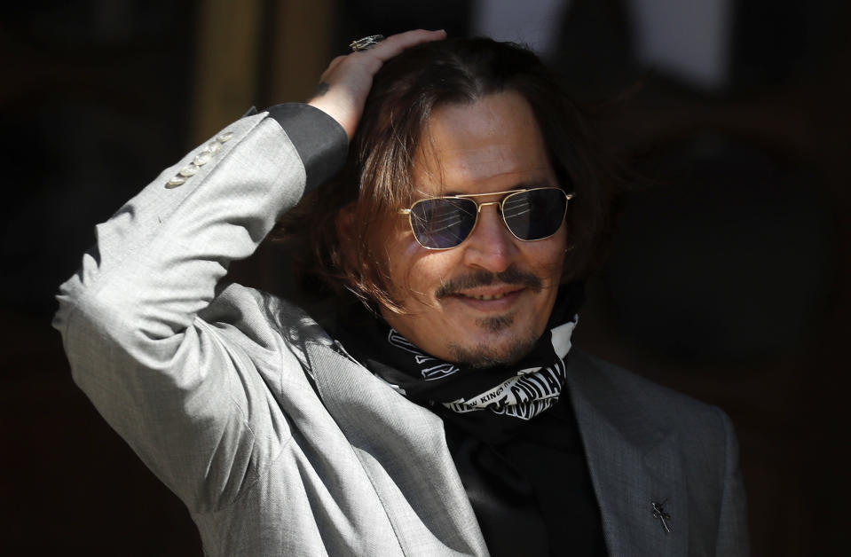 "FILE - In this file photo dated Tuesday, July 28, 2020, US Actor Johnny Depp arrives at the High Court in London during his case against News Group Newspapers over a story published about his former wife Amber Heard, which branded him a 'wife beater'. A British judge is set to deliver his judgement in writing on Monday Nov. 2, 2020, deciding whether a tabloid newspaper defamed Depp by calling him a ""wife beater."" (AP Photo/Frank Augstein, FILE)"