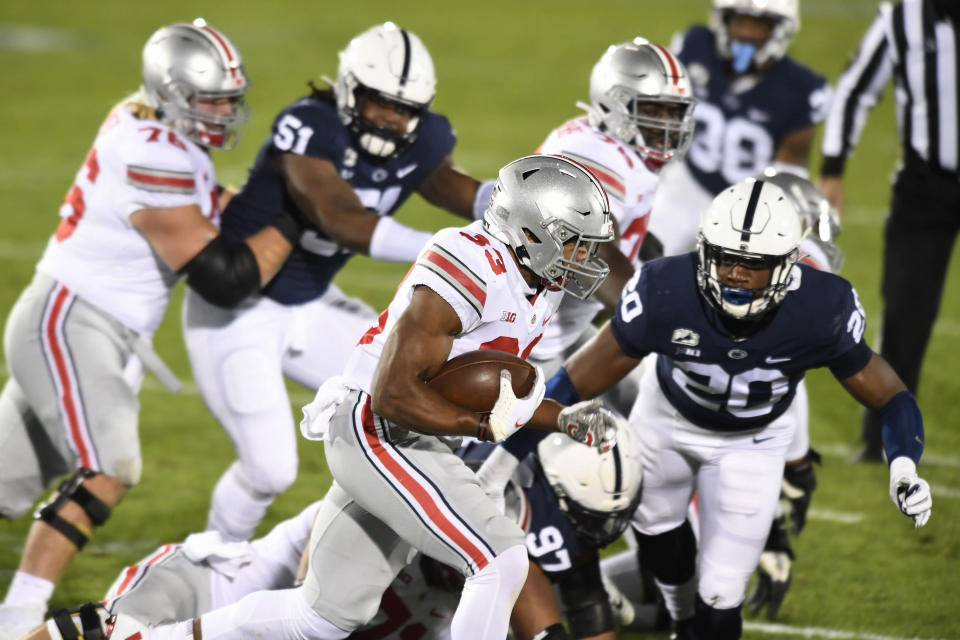 Ohio State running back Master Teague (33) carries against Penn State in the first quarter of an NCAA college football game in State College, Pa., Saturday, Oct. 31, 2020. (AP Photo/Barry Reeger)