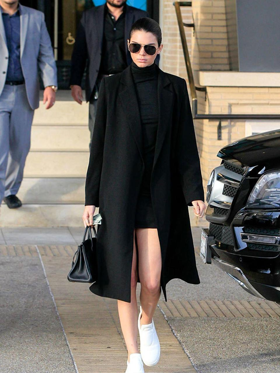 <p>Kendall Jenner channeling her sister Kim K in this all black ensemble in LA, December 2015.</p>