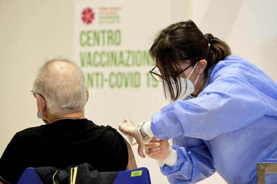 A person receives his shot of vaccine against Covid-19 as the vaccination campaign continues on Easter Day in Rome, Sunday, April 4, 2021. Italy has entered a three-day strict nationwide lockdown to prevent new surges of the coronavirus. Police set up road checks to ensure people were staying close to home and extra patrols were ordered up to break up large gatherings in squares and parks, which over Easter weekend are usually packed with picnic-goers. (Mauro Scrobogna/LaPresse via AP)