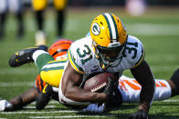 Green Bay Packers safety Adrian Amos (31) dives forward after an interception against the Cincinnati Bengals in the second half of an NFL football game in Cincinnati, Sunday, Oct. 10, 2021. (AP Photo/AJ Mast)