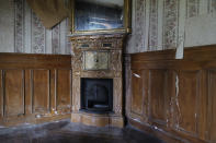 """The fireplace of the 120 sq. meters (1,300 sq. feet) stone house where the Nobel-winning scientist couple Marie Sklodowska-Curie and Pierre Curie spent vacation and weekends from 1904-1906 in Saint-Remy-les-Chevreuse, on the south-west outskirts of Paris, France, Wednesday, May 12, 2021. Poland's prime minister Mateusz Morawiecki says he's given instructions for the government to buy 790,000 euro house in France, and said on Twitter Tuesday that the house, is a """"part of Poland's history."""" (AP Photo/Francois Mori)"""