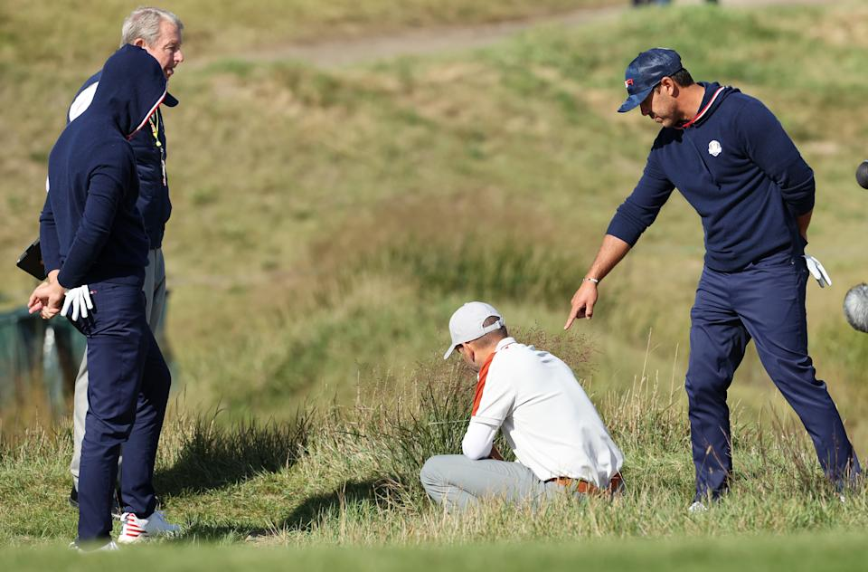KOHLER, WISCONSIN - SEPTEMBER 25: Daniel Berger of team United States, Brooks Koepka of team United States, and Sergio Garcia of Spain and team Europe inspect the lie of a ball on the 15th hole during Saturday Morning Foursome Matches of the 43rd Ryder Cup at Whistling Straits on September 25, 2021 in Kohler, Wisconsin. (Photo by Warren Little/Getty Images)