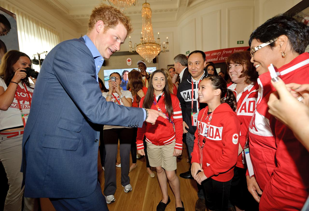Prince Harry meets a young Olympic fan at Canada Olympic House, London, Thursday Aug. 2, 2012. (Canadian Olympic Committee Photo)