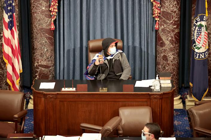A protester sits in the Senate Chamber on January 06, 2021 in Washington, DC. (Win McNamee/Getty Images)