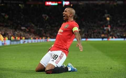 Ashley Young celebrates Man United's first goal - Credit: AFP
