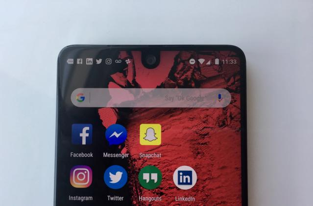 The Essential Phone's screen runs all the way to the top and wraps around the front-facing camera. Source: JP Mangalindan/Yahoo Finance