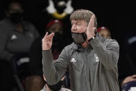 North Carolina State head coach Wes Moore directs his players during the second half of an NCAA college basketball game against North Carolina in Chapel Hill, N.C., Sunday, Feb. 7, 2021. (AP Photo/Gerry Broome)