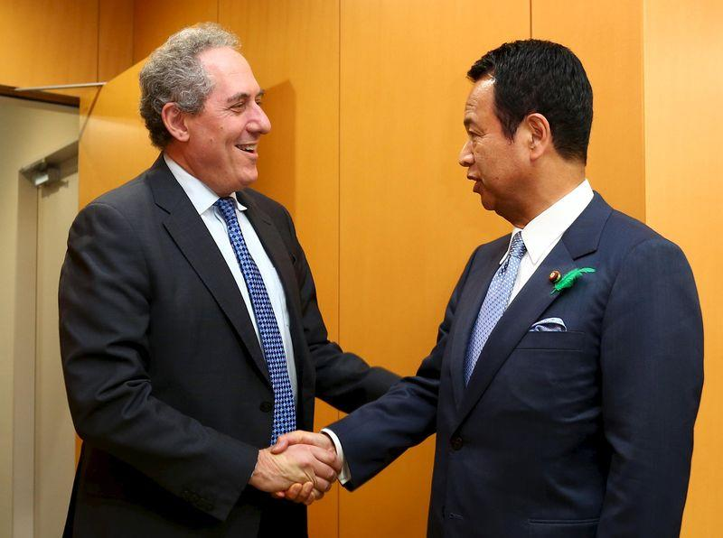 Japan's Economics Minister Amari shakes hands with U.S. Trade Representative Froman ahead of their meeting in Tokyo