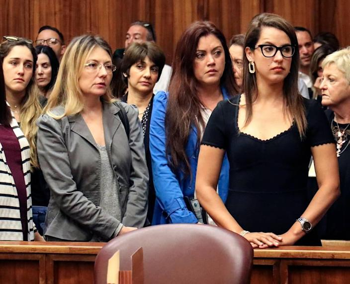 On Wednesday, January 29, 2020 Amir Pelleg's wife, Zulma Pelleg, right, looks towards Joseph Franco's family and supporters, a Miami man who was high on 'whippets' when he hit and killed Sunny Isles lawyer Amir Pelleg as he walked with his wife down A1A, after Franco pleaded guilty and arrested.