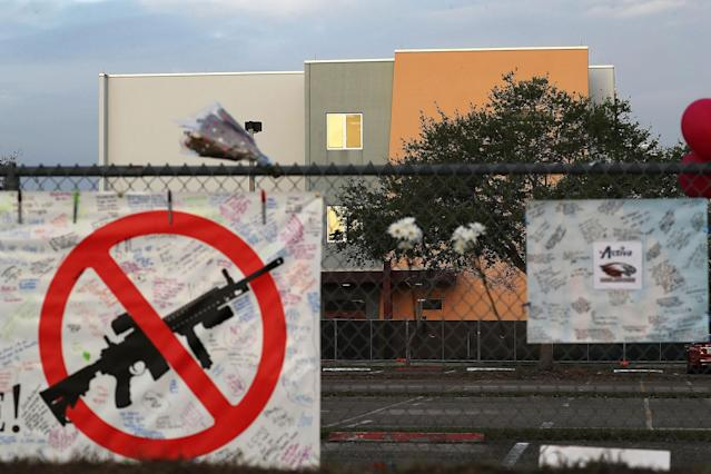 <p>A sign is seen on the fence around Marjory Stoneman Douglas High School in front of the freshman dorm where a mass shooting took place on campus on February 23, 2018 in Parkland, Fla. (Photo: oe Raedle/Getty Images) </p>