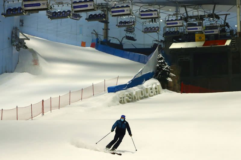 A man wears a protective face mask as he skis at Ski Dubai during the reopening of malls, following the outbreak of the coronavirus disease (COVID-19), at Mall of the Emirates in Dubai