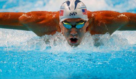 Michael Phelps competes during the men's 200m butterfly preliminary heats in the U.S. Olympic swimming team trials at CenturyLink Center in Omaha