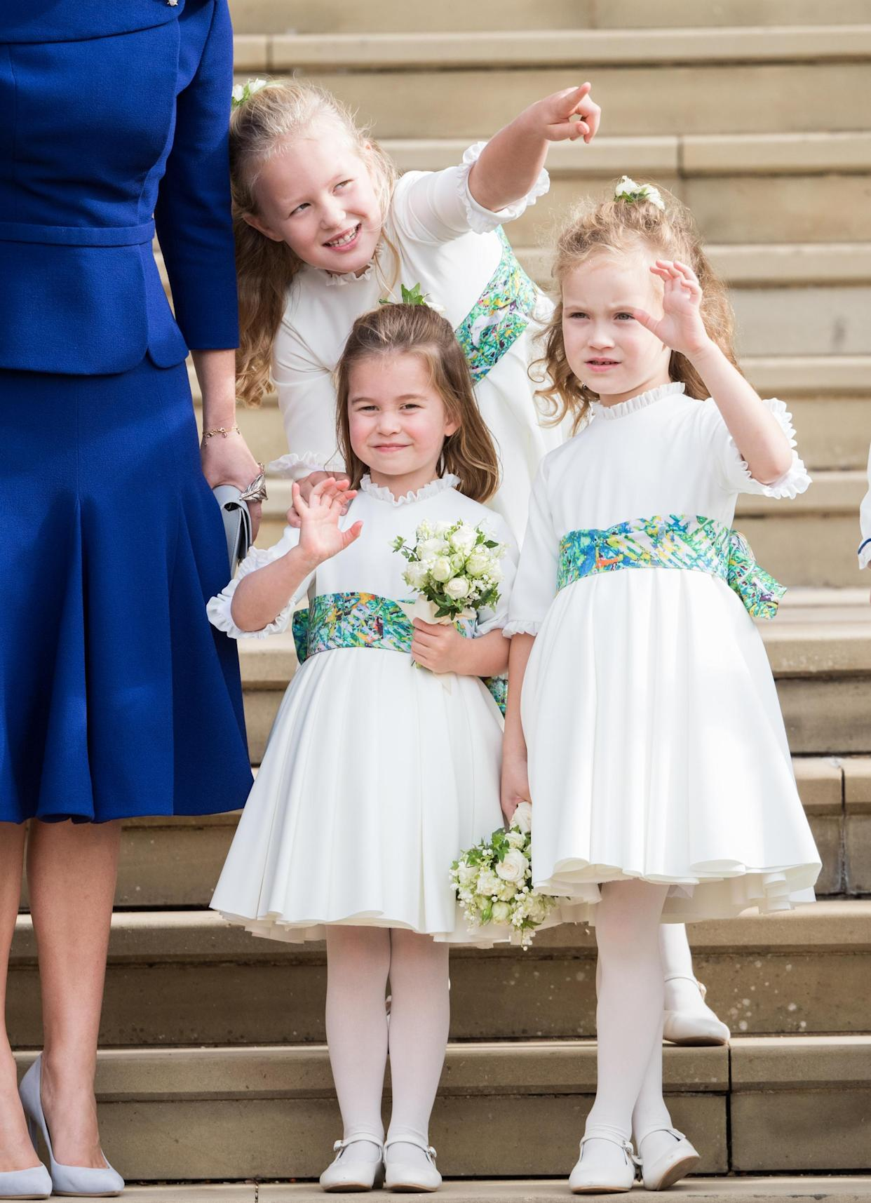 WINDSOR, ENGLAND - OCTOBER 12:  Bridesmaids Princess Charlotte of Cambridge, Savannah Phillips and Maud Windsor after the wedding of Princess Eugenie of York and Jack Brooksbank at St. George's Chapel on October 12, 2018 in Windsor, England.  (Photo by Pool/Samir Hussein/WireImage)