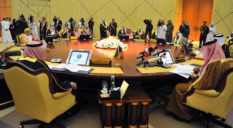 In this Sunday, March 4, 2012 photo provided by Saudi Press Agency, foreign ministers of the Gulf Cooperation Council meet in Riyadh, Saudi Arabia. Around a gold-draped hall in Saudi Arabia, Gulf envoys listened to their host declare the Syrian regime an enemy of its people and the region. What they really heard were fresh salvos in the Arab Spring's wider war: Saudi leaders and their Gulf partners hoping to deal crippling blows to Iran's footholds in the Middle East. (AP Photo/Saudi Press Agency)