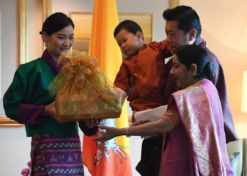 Indian Foreign Minister Sushma Swaraj presenting gifts King Jigme Khesar Namgyel Wangchuck, Queen Jetsun Pema and prince Jigme Namgyel Wangchuck in New Delhi in November 2017.