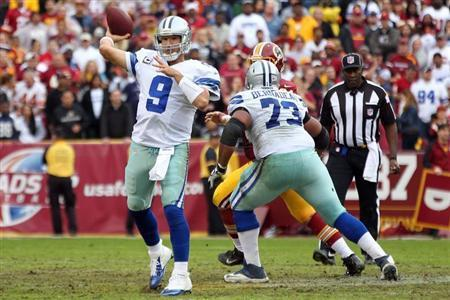 Dallas Cowboys quarterback Tony Romo (9) throws the ball against the Washington Redskins in the second quarter at FedEx Field. Geoff Burke-USA TODAY Sports