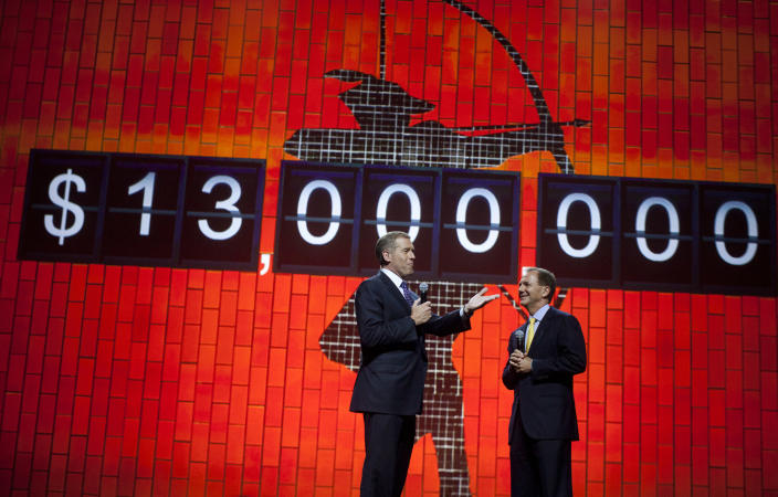 News anchor Brian Williams and Robin Hood Foundation Founder Paul Tudor Jones speak at the Robin Hood Foundation Benefit at the Jacob K Javits Convention Center in New York May 14, 2012. REUTERS/Andrew Kelly (UNITED STATES - Tags: ENTERTAINMENT)