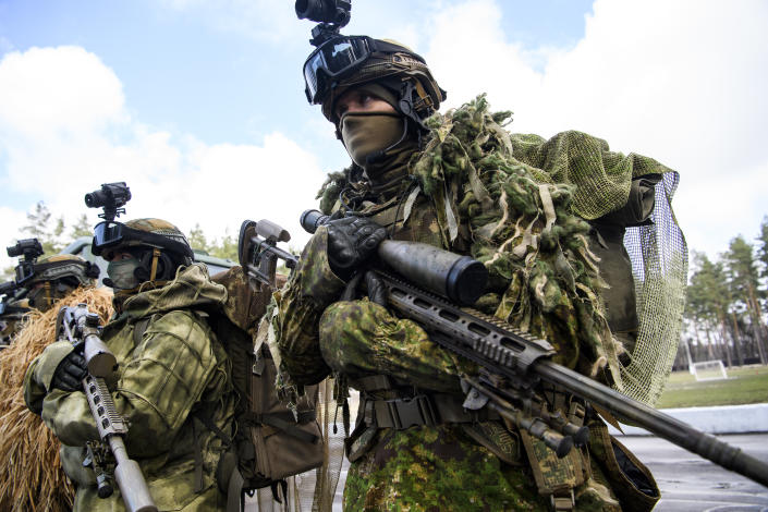 Snipers in camouflage suits