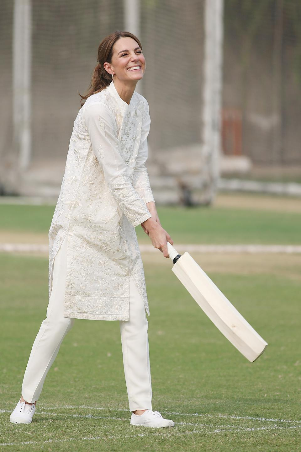 """Kate wore a chic all-white outfit on day four, which was made up of a traditional embroidered shalwar kameez, which had been custom made by Pakistani brand, Gul Ahmed. The 37-year-old finished off the look with<a href=""""https://fave.co/2Jd7cXd"""" rel=""""nofollow noopener"""" target=""""_blank"""" data-ylk=""""slk:affordable £28 trainers"""" class=""""link rapid-noclick-resp""""> <strong>affordable £28 trainers</strong></a> by British brand, Hampton Canvas. [<em>Photo: Getty]</em>"""