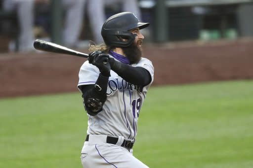 Colorado Rockies' Charlie Blackmon watches his three-run double against the Seattle Mariners during the fifth inning of a baseball game Saturday, Aug. 8, 2020, in Seattle. (AP Photo/Elaine Thompson)