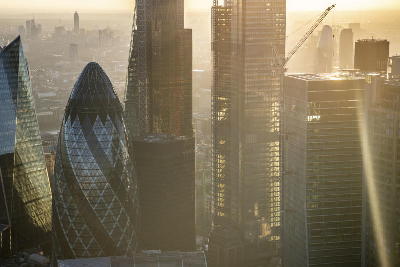 Sunset looking through the towers in the City of London with the construction of 22 Bishopsgate. (Photo: Jason Hawkes/Caters News)