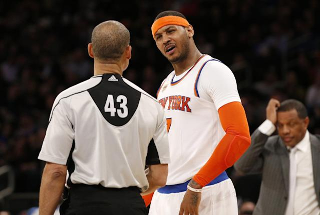 "<a class=""link rapid-noclick-resp"" href=""/nba/players/3706/"" data-ylk=""slk:Carmelo Anthony"">Carmelo Anthony</a> questions referee Dan Crawford, moments before picking up two technical fouls and getting ejected. (AP)"