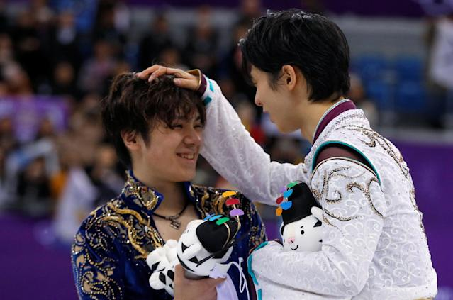 Figure Skating - Pyeongchang 2018 Winter Olympics - Men Single free skating competition final - Gangneung, South Korea - February 17, 2018 - Gold medallist Yuzuru Hanyu of Japan and silver medallist Shoma Uno of Japan celebrate. REUTERS/Phil Noble TPX IMAGES OF THE DAY