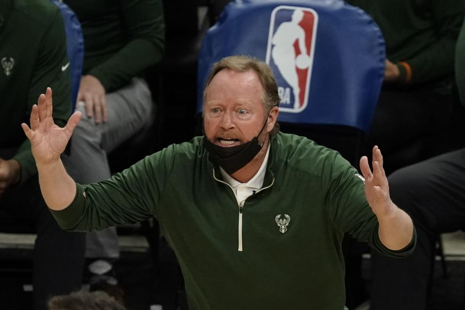 Milwaukee Bucks head coach Mike Budenholzer reacts to a call during the second half of an NBA basketball game against the Toronto Raptors Thursday, Feb. 18, 2021, in Milwaukee. (AP Photo/Morry Gash)
