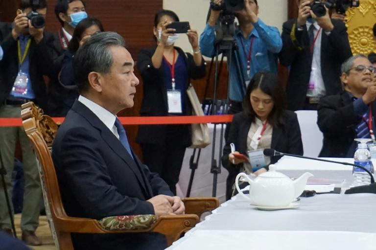Chinese Foreign Minister Wang Yi (L) says his country's efforts to control the coronavirus outbreak are working