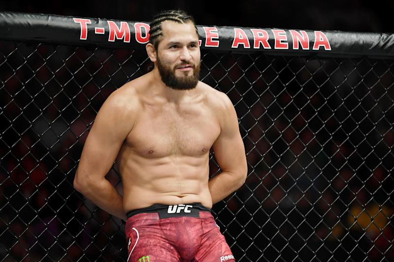 Jul 6, 2019; Las Vegas, NV, USA; Jorge Masvidal (red gloves) stands with his hands behind his back before his fight against Ben Askren (blue gloves) at T-Mobile Arena. Jorge Masvidal set a new record for the fastest knockout in UFC history with five seconds. Mandatory Credit: Stephen R. Sylvanie-USA TODAY Sports
