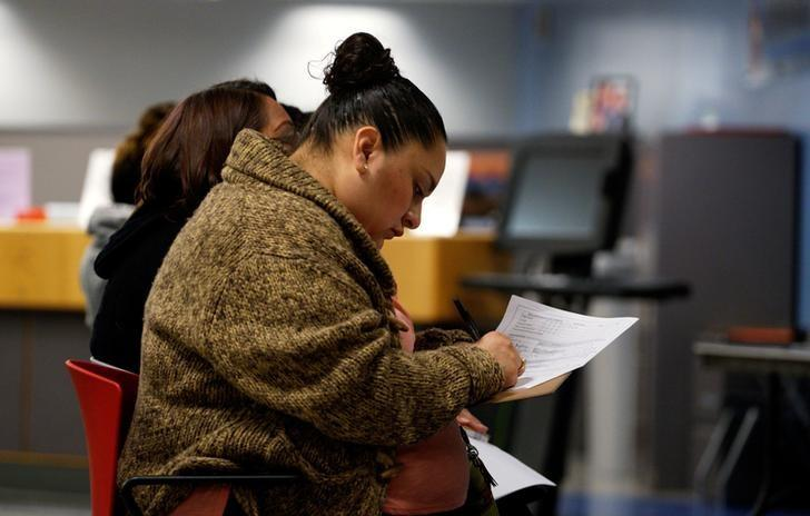 A job seeker fills out an application at a job fair at the Denver Workforce Center in Denver, Colorado, U.S. on February 15, 2017. REUTERS/Rick Wilking/File Photo