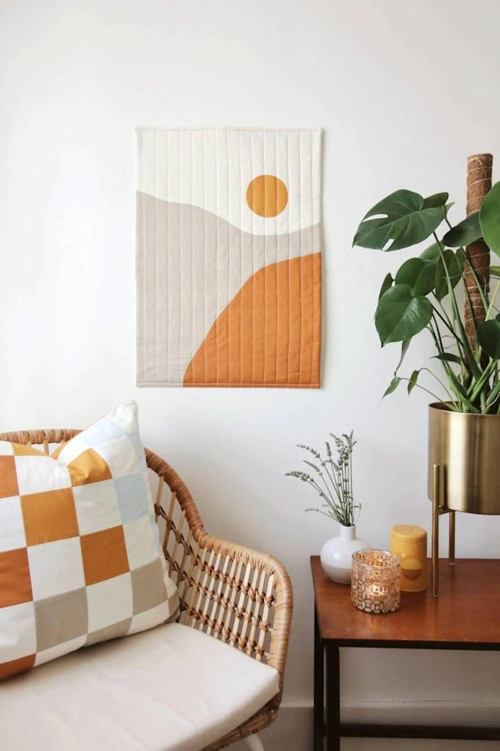 <p>This <span>Sunrise Modern Quilted Wall Decor</span> ($173) will add texture and color to your living room wall. It's an eye-catching piece that will have guests wondering where it's from.</p>