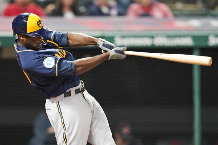 Milwaukee Brewers' Lorenzo Cain hits a grand slam during the fifth inning of the team's baseball game against the Cleveland Indians, Friday, Sept. 10, 2021, in Cleveland. (AP Photo/Tony Dejak)