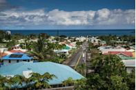 """<p>The town of Hilo is nestled along the <a href=""""https://go.redirectingat.com?id=74968X1596630&url=https%3A%2F%2Fwww.tripadvisor.com%2FTourism-g60583-Hilo_Island_of_Hawaii_Hawaii-Vacations.html&sref=https%3A%2F%2Fwww.esquire.com%2Flifestyle%2Fg35036575%2Fsmall-american-town-destinations%2F"""" rel=""""nofollow noopener"""" target=""""_blank"""" data-ylk=""""slk:Big Island's largest harbor"""" class=""""link rapid-noclick-resp"""">Big Island's largest harbor</a> and boasts beautiful waterfalls with stellar views. Just south of the tropical retreat is Volcanoes National Park, home to some of the most active volcanoes in the world.</p>"""