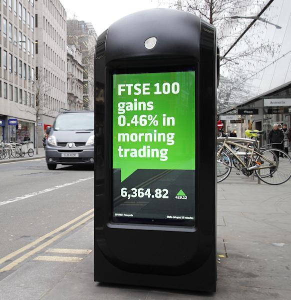 A garbage bin with TV screens on the side show the numbers for early morning trading on the stock exchange in the City of London, Monday, Feb. 25, 2013. The British pound is recovering after dropping against the world's leading currencies as markets reacted to a downgrade of the U.K.'s cherished triple-A credit rating. The pound was in focus in the wake of last Friday's decision by Moody's to downgrade the U.K.'s credit rating by one notch from the top AAA to AA1. The agency says sluggish growth and rising debt are weakening the British economy's outlook. (AP Photo/Alastair Grant)