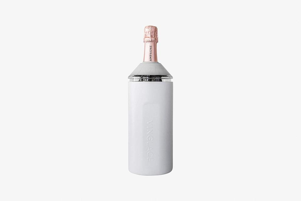 """If you've got people on your list who like to travel, chances are, they like wine. And this double-walled, insulated bottle chiller will keep <a href=""""https://www.cntraveler.com/story/beginners-guide-to-visiting-champagne?mbid=synd_yahoo_rss"""" rel=""""nofollow noopener"""" target=""""_blank"""" data-ylk=""""slk:Champagne"""" class=""""link rapid-noclick-resp"""">Champagne</a> or anything else you want chilled for hours. We like it for its sleek design, but your giftee may also appreciate that it's immensely portable—perfect for a picnic or short getaway. Order the last-minute Christmas gift in one of six colors, including the white style shown here. $90, Amazon. <a href=""""https://www.amazon.com/Vinglace-Stainless-Steel-Wine-Insulator/dp/B07FWBCBJH"""" rel=""""nofollow noopener"""" target=""""_blank"""" data-ylk=""""slk:Get it now!"""" class=""""link rapid-noclick-resp"""">Get it now!</a>"""