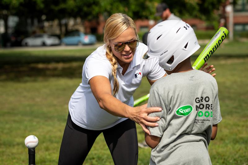 Jennie Finch gives hitting tips to a student from Ray Elementary. (Photo by Dylan Buell/MLB Photos via Getty Images)