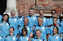 Mattia Maestri, top row, third from left, poses for a group photo prior to the start of a 180-kilometer relay race, in Codogno, Italy, Saturday, Sept. 26, 2020. Italy's coronavirus Patient No. 1, whose case confirmed one of the world's deadliest outbreaks was underway, is taking part in a 180-kilometer relay race as a sign of hope for COVID victims after he himself recovered from weeks in intensive care. Mattia Maestri, a 38-year-old Unilever manager, was suited up Saturday for the start of the two-day race between Italy's first two virus hotspots. It began in Codogno, where Maestri tested positive Feb. 21, and was ending Sunday in Vo'Euganeo, where Italy's first official COVID death was recorded the same day. (AP Photo/Antonio Calanni)